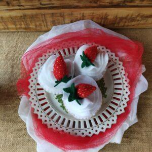 Cream cake with strawberry topper